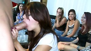 Redhead girls giving head in a club