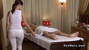 Busty masseuse less undershirt gives massage