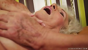A very hairy granny stimulates their way old clit