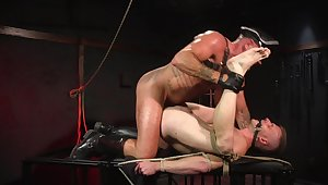 Gay slave endures rough anal in BDSM sex play