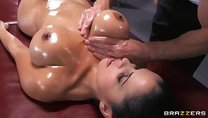 Young suntanned main with tight and unmitigatedly big boobs Diamond Kitty being oiled up and fucked in ass by Johnny Sins.