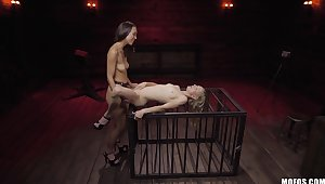 Nude lesbians share the strap-on in  their first femdom tryout