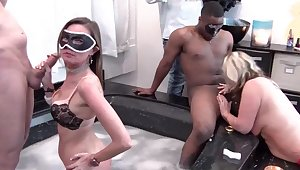 Busty MILFs sucks monster dicks in Jacuzzi at a swingers party
